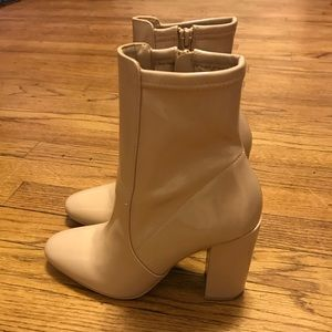Nude patent leather booties